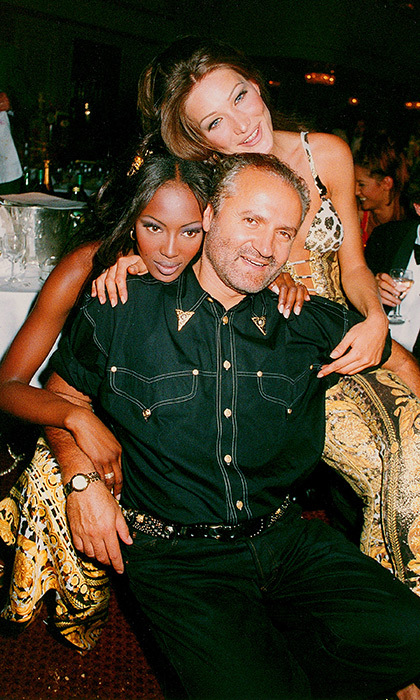 Versace-clad models Naomi Campbell and Carla Bruni snuggled up to the sartorial icon in 1992. The trio was attending the Save the Rainforest Gala at the Grovesnor House Hotel in London.