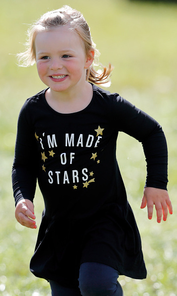 She's always been such a happy girl - and is definitely made of stars! Mia happily ran through the grass in the summer of 2017.