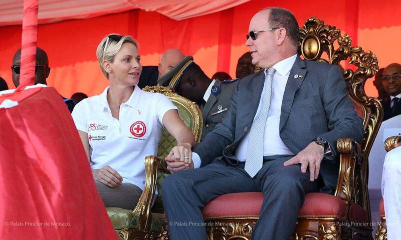 Princess Charlene and Prince Albert shared a sweet moment during their visit holding hands while seated in two elaborate chairs.