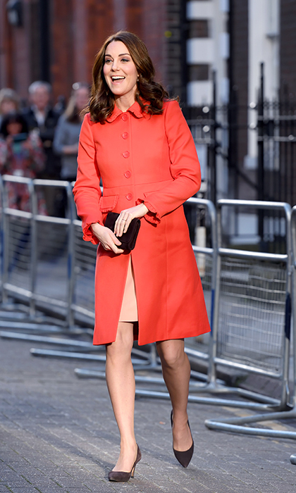 The Duchess brought some colour to a sunny London day while visiting Great Ormond Street Hospital! Kate was spotted wearing a bright red coat by the affordable brand Boden.