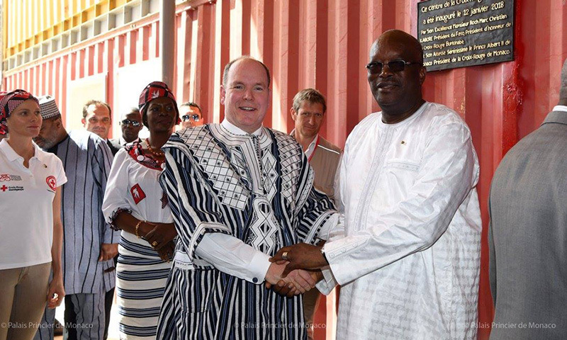 Prince Albert donned traditional African clothing during an outing on his trip.