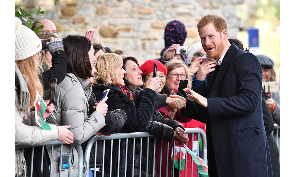 <p>Prince Harry was pictured joking with members of the public as he spent time chatting to them outside Cardiff Castle in the centre of the capital on Thursday afternoon. </p>