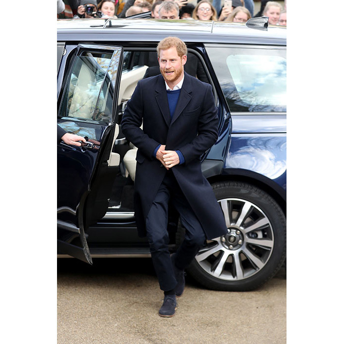 <p>Prince Harry looked smart dressed in a crisp white shirt, navy trousers and a blue jumper during his visit to Cardiff on Thursday. The 33-year-old wrapped up warm in a long navy coat as he stepped out to see the adoring crowds waiting to catch a glimse of the royal couple. </p>