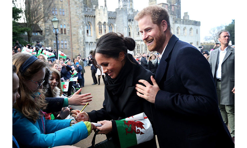 <p>Meghan Markle delighted a royal fan during her visit to Cardiff - breaking royal protocol by doing so. The soon-to-be-royal signed an autograph for a young girl who had queued for hours outside Cardiff Castle to get a glimpse of the couple, while her fiancé Prince Harry stood by her side. Royals are typically expected to politely decline fans requests for an autograph, due to the risk of it being forged. </p>