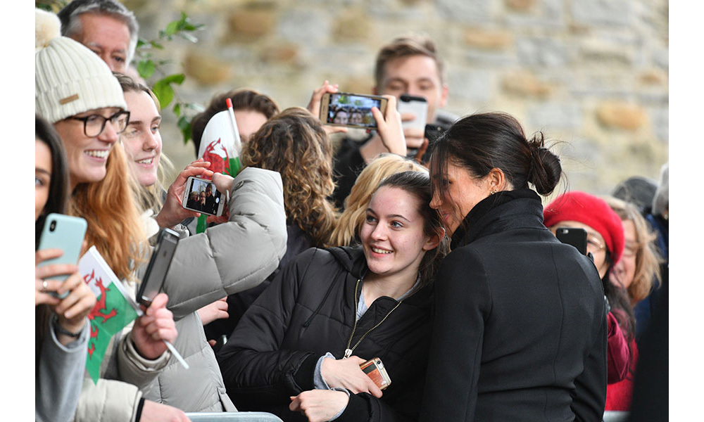 "<p>Signing an autograph wasn't the only royal protocol Meghan broke during the walkabout in Cardiff on Thursday. The former Suits star also posed for a selfie with another fan, despite saying she was ""not allowed"" to take photos with members of the public during a previous engagement.</p>