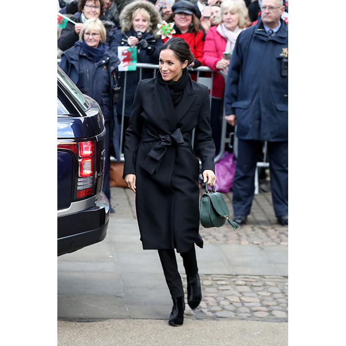 <p>Meghan Markle was all smiles as she greeted crowds in Cardiff on Thursday. To accessorise her £1350 black Stella McCartney coat, the former actress added a touch of colour with a gorgeous £165 green tote bag by luxury handbag designer DeMellier - a nod to the Welsh flag.</p>