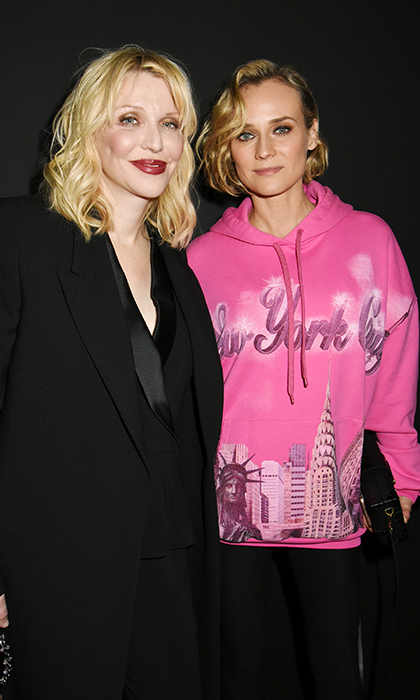 Looking cool and casual, Diane Kruger - in a bright pink New York City hoodie - posed for a photo alongside the iconic Courtney Love. The two were also at YSL's beauty party during Paris Fashion Week.