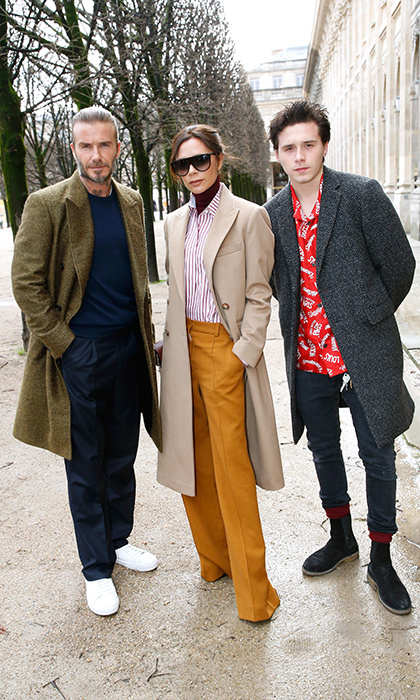 Impeccable fashion sense runs in the Beckham family! Victoria, David and their eldest son Brooklyn stepped out in Paris looking chic as ever during Paris Fashion Week.