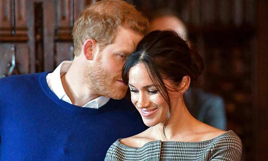What was Prince Harry whispering to Meghan?!