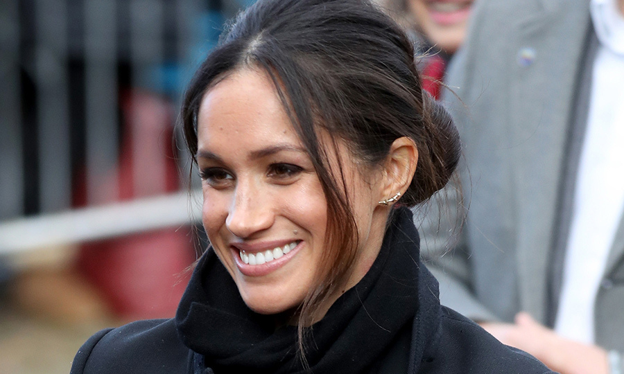 Meghan Markle has the messy bun down pat! For her third official royal outing with the love of her life, Prince Harry, Meghan looked chic with her hair in a low bun, and some loose strands framing her face. The royal-to-be was all smiles for her stylish day out in Wales!
