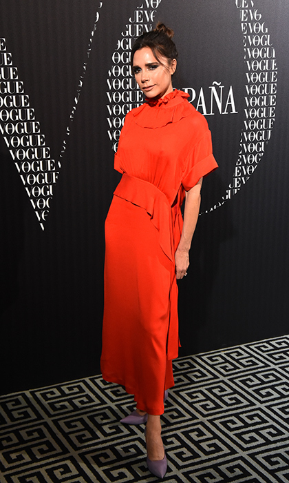 Victoria Beckham's fashion sense is the gift that keeps on giving. Only this Spice Girl-turned-designer would think of pairing powder purple with bright red - and she's working it! The star attended a dinner to celebrate <em>Vogue</em>'s February issue release in Madrid after stopping in Paris for Fashion Week.