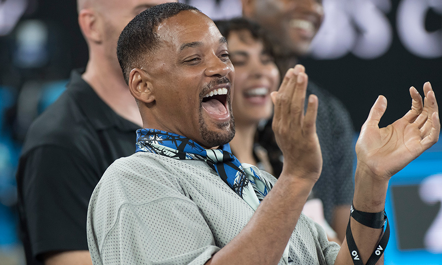 Will Smith has got to be the happiest guy in Hollywood! When is he ever <em>not</em> smiling?! The iconic actor cheered while at an Australian tennis match on Jan. 19.<p>Photo: © Getty Images