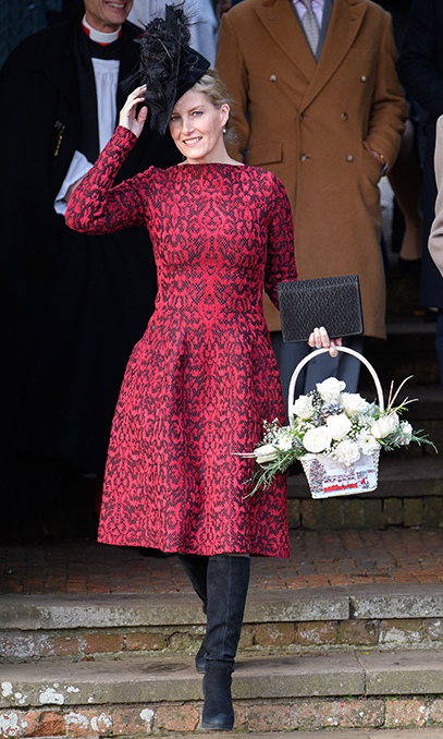 <p>On Christmas Day 2016, Sophie was a lady in red, sporting a delightful skater-style frock by Alaia, featuring an intricate lace overlay. The flared skirt was a flattering fit that made the most of her lean frame. She wore a beautiful statement hat by Jane Taylor and carried a matching clutch bag.