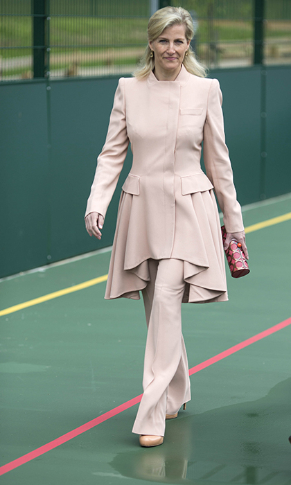 <p>The Countess of Wessex opened a new sports facilities at Treloar College on June 4, 2014 and showed off her slim physique in a blush pink coat that featured a graduated, flared hem, which she teamed with matching tailored trousers. The polished style was smart yet feminine. We love her loose hairstyle and gold drop earrings.</p>