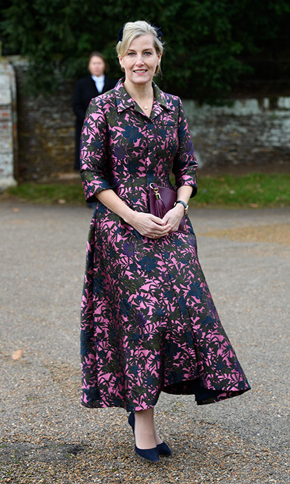 <p>Mother-of-two Sophie turned heads on Christmas Day as she attended a festive church service in Sandringham. She stepped out in a vibrant purple and pink hued coat dress by Erdem, which she paired with classic navy high-heel pumps, a burgundy clutch bag and a subtle yet chic hat.</p>