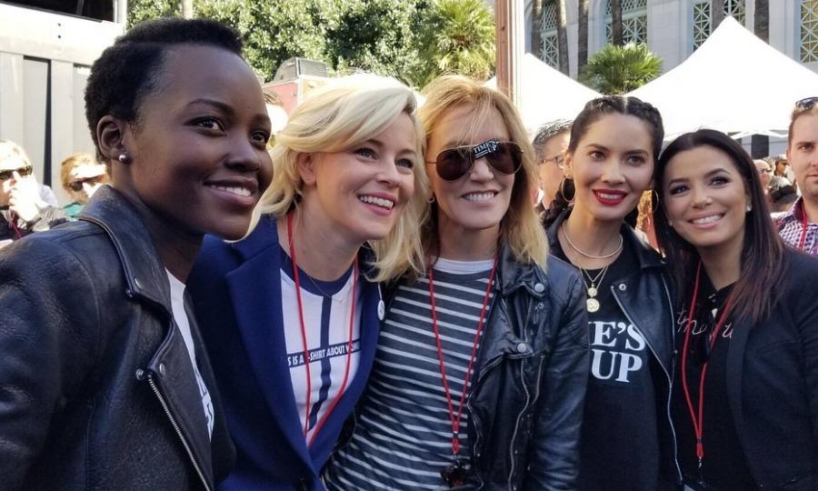 "Among her Instagram photos from the day, Lupita also shared a group shot of her with fellow celebs Elizabeth Banks, Felicity Huffman, Olivia Munn and Eva Longoria. The fivesome were all smiles as they posed backstage at the L.A. march, fighting for equality. Elizabeth wore pins on her outfit that said ""100% human"" and ""Babes unite."" 
