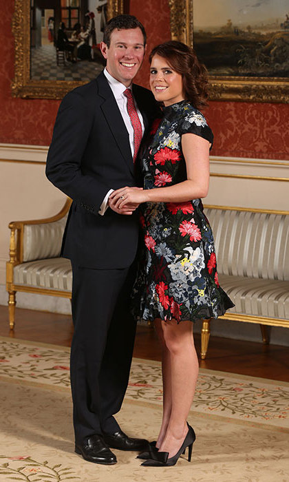 Princess Eugenie and her long-term boyfriend Jack Brooksbank are officially engaged! The Princess - who stunned in a floral dress and adorable black satin heels - showed off her gorgeous engagement ring in the official portraits released on Jan. 22.