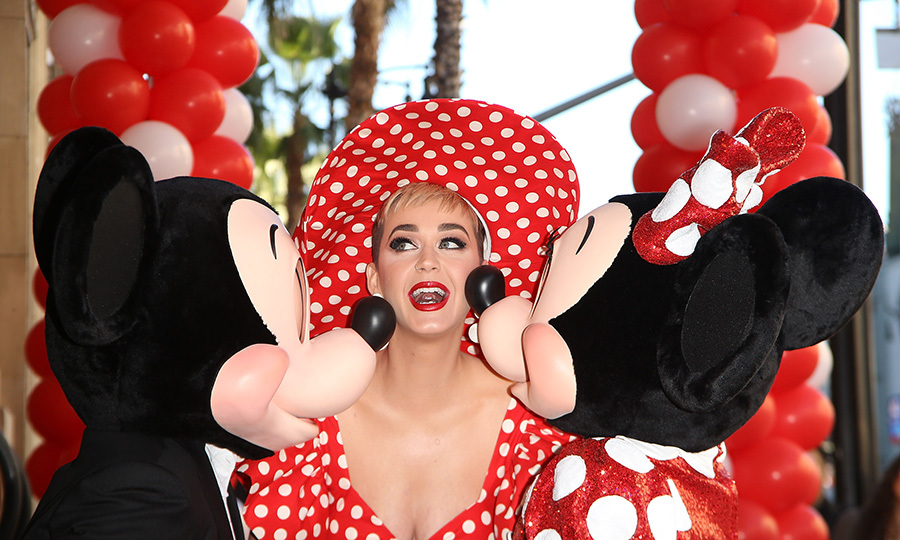 Katy Perry got a kiss from Micky and Minnie Mouse while attending her Hollywood Walk of Fame ceremony! The pop star looked totally adorable in red-and-white polka dots.