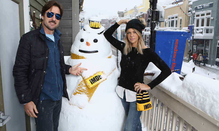 Luke Wilson and Kaitlin Olson of <em>Arizona</em> didn't let the snowstorm stop them from going outside to build a snowman at the IMDb Studio. 