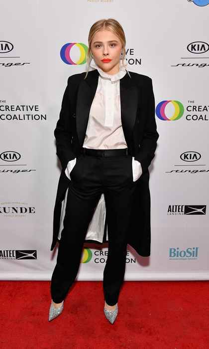 "Chloe Grace Moretz was sans boyfriend Brooklyn Beckham while attending the Creative Coalition's 2018 Spotlight Initiative Awards Gala Dinner at the KIA Supper Club, though she did honour his mom by wearing a head-to-toe look by the designer. Chloe, who attended the festival to promote <em>The Miseducation of Cameron Post</em>, accepted her award and shared: ""We made this film about a girl that gets sent to gay conversion therapy after being caught with a girl...and this is still legal in 45 out of 50 states."" She dedicated the award to the LGBT community. 