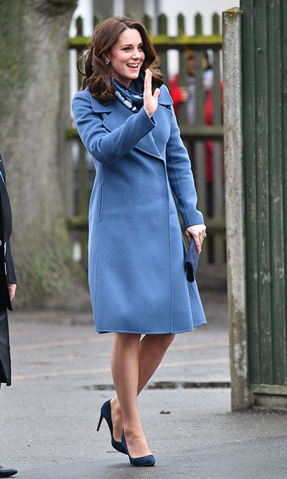 While on a royal outing to visit Roe Green Junior School in London, the pregnant royal looked incredible as she braved the cold and rain in a bright blue coat by Sportmax, dress by Seraphine, printed scarf by Beluah London and navy shoes.