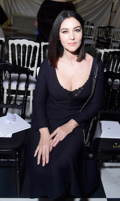Italian actress and model Monica Bellucci wowed in a simple black dress and matching bag at Dior's Haute Couture presentation.