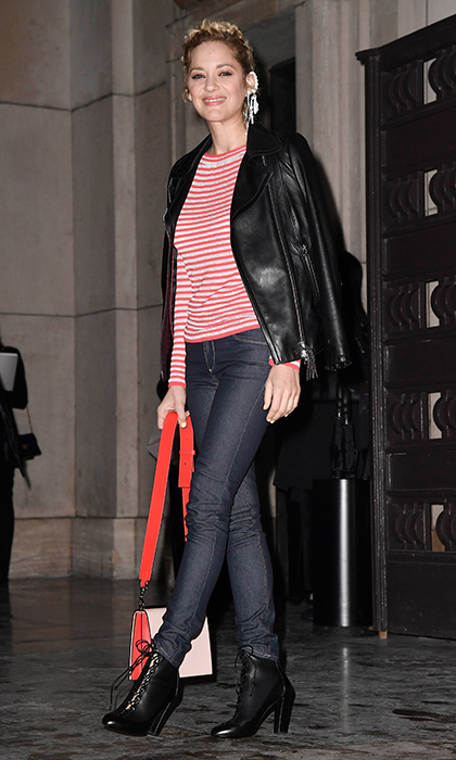Marion Cotillard was the picture of Parisian cool in a striped top, leather biker jacket and dark wash jeans while flashing the camera a smile!