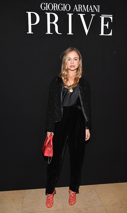 Lady Amelia Windsor was giving us major velvet envy while at the Armani Prive presentation! She paired her velvet and satin ensemble with red shoes and a matching handbag for a pop of colour.