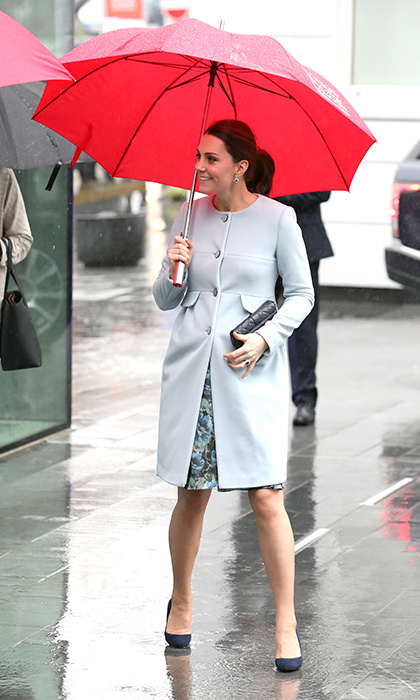 Nobody can rain on Kate's fashion parade! The Duchess of Cambridge braved the gloomy weather with a smile on her face, donning a stunning powder blue Seraphine coat. The pregnant royal was visiting the Maurice Wohl Clinical Neuroscience Institute at the Institute of Psychiatry, Psychology & Neuroscience at King's College on Jan. 24.