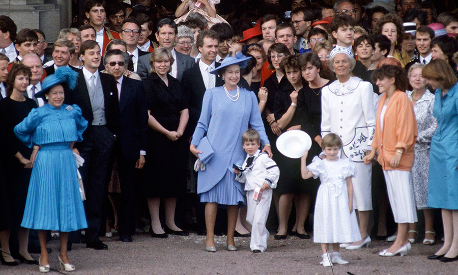 <p>The royal family and household staff gathered to bid farewell to the Duke and Duchess of York as they headed off on their honeymoon. Queen Elizabeth II has her arm around grandson Prince William, centre, while on the left is Queen Elizabeth's sister Princess Margaret. </p>
