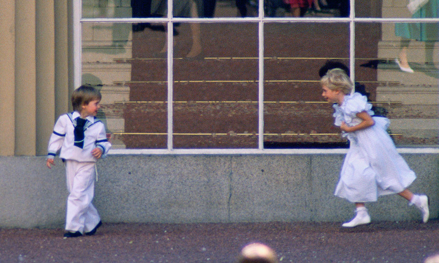 <p>The scene at Buckingham Palace was a joyous one – here little Prince William is pictured without his hat as he played with his eight-year-old royal cousin Lady Davina Windsor. </p>