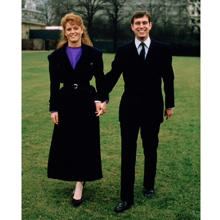 <p>Prince Andrew popped the question with a Burmese ruby ring from Garrard, the choice of gem inspired by the future bride's red hair. The couple announced their engagement in March 1986, posing for this photo on the grounds of Buckingham Palace.</p>