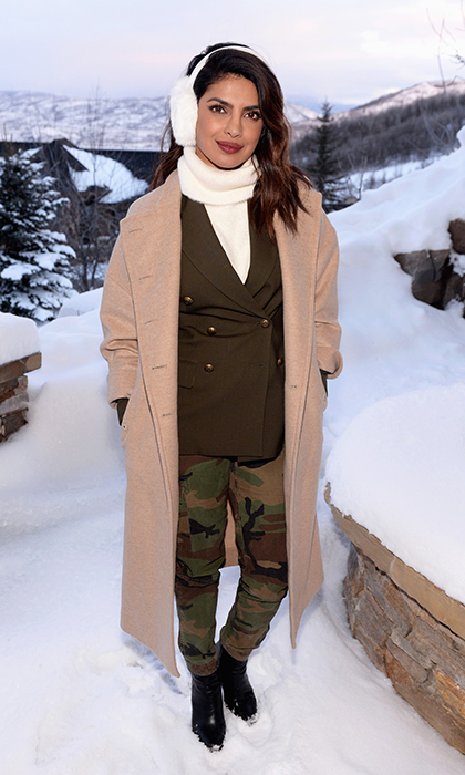 Take notes, fashion lovers! Priyanka Chopra has the neutral look down pat. Wearing not one, but two, coats, the star paired her look with camouflage pants and adorable ear muffs.