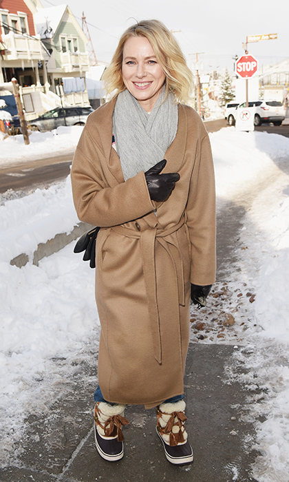 Naomi Watts bundled up in a cute camel sashes coat, a simple grey scarf and big winter boots. Flashing the camera her winning smile, she arrived at Sundance for some movie time!