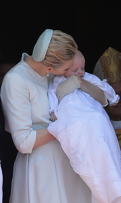 <p>Grace Kelly's daughter-in-law gave one of her babies a smooch after Jacques and Gabriella's baptism at the Monaco Cathedral in 2015.</p>