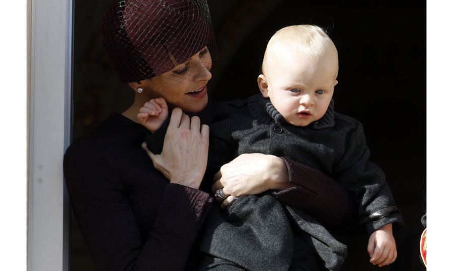 <p>The doting mom held on to Prince Jacques as they greeted well-wishers from the palace's balcony during Monaco's National Day celebrations in 2015.</p>