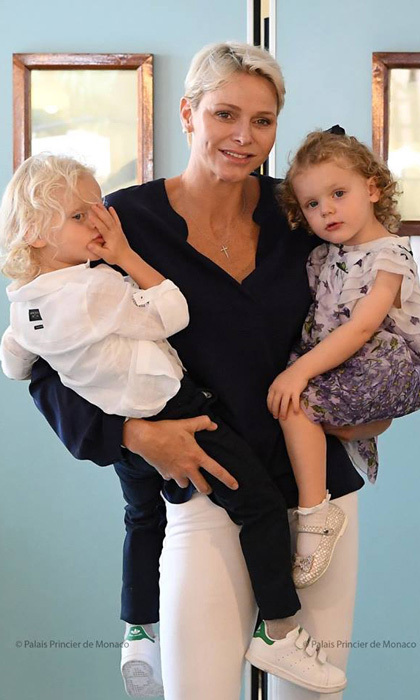 <p>Princess Charlene was one super mom carrying both of her kids during their visit to the Hector Otto Foundation in 2017. The trio visited senior citizens and passed out baskets and photos to residents.</p>