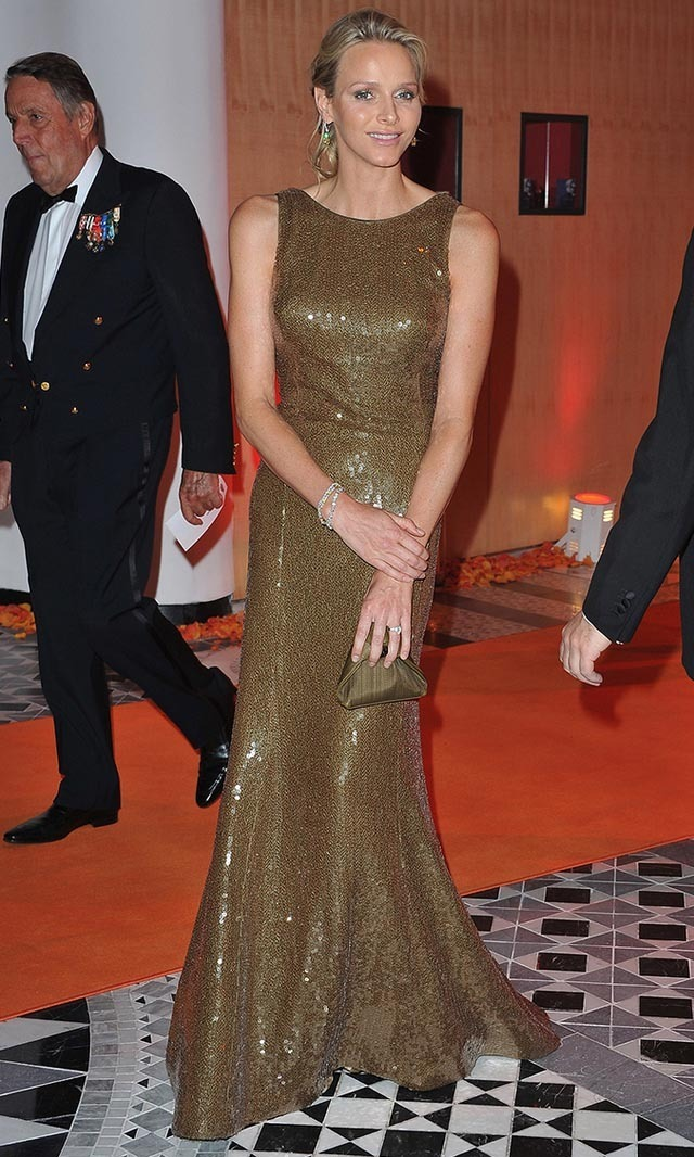 <p>May 2011: Charlene wowed at a Formula One gala dinner in Monaco in this glittering metallic dress.</p>