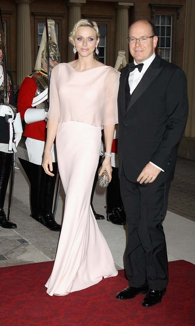 <p>May 2012: Charlene slipped into an elegant pale pink ensemble for a dinner party hosted by Prince Charles and Duchess Camilla. </p>