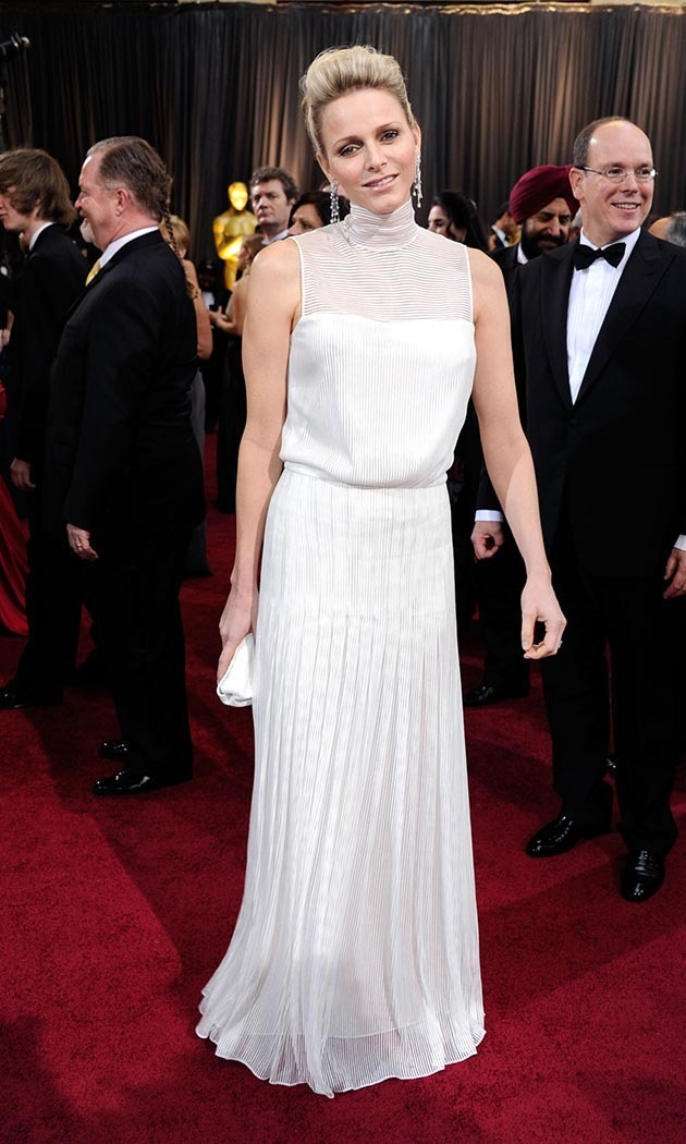 <p>February 2012: Attending the Academy Awards in a high-necked white gown by Akris. </p>