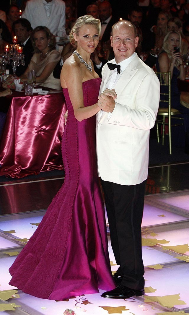 <p>August 2011: Looking like a Hollywood star in a deep magenta gown while gracing the dance floor with Prince Albert ll at the Red Cross gala. </p>
