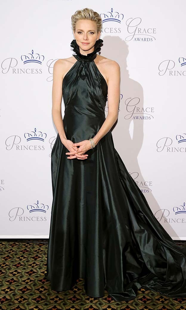 <p>October 2013: Charlene wore a rich dark-green taffeta gown by Ralph Lauren at the Princess Grace awards. </p>