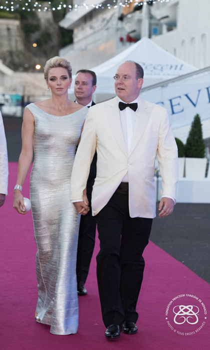 <p>July 2016: Princess Charlene dazzled in a silver gown alongside her husband Prince Albert as sge christen the Seven Seas Explorer cruise ship.</p>