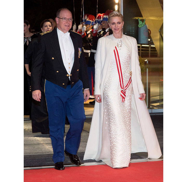 <p>November 2016: Prince Albert's wife looked regal arriving to the Monaco National Day Gala wearing a white embellished gown by one of her favorite designers, Akris. Charlene paired the stunning dress with a matching floor-length coat.</p>