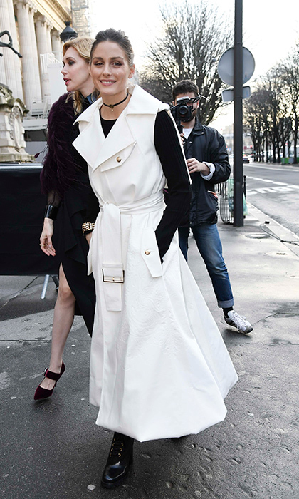 Olivia Palermo channeled some '90s vibes with a stylish choker and an extravagant sleeveless trench coat.