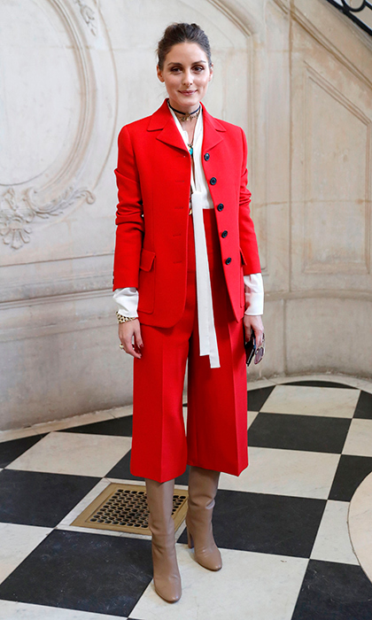 Olivia is one fashion maven who understands colour! The socialite and designer stunned in bright red at Christian Dior's Paris show.