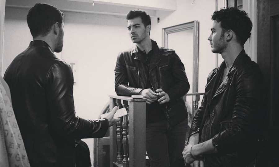 Kevin Jonas caused a stir when he shared a photo with his brothers Nick and Joe in the throes of a serious discussion on Friday, January 26. Fans went wild over the black-and-white Instagram pic, immediately wondering if the Jonas Brothers were back together. The post comes just a week after the brothers reactivated their official band account.