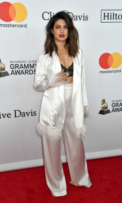 Priyanka Chopra brought the frills to Clive Davis and the Recording Academy's outing, which honoured Jay-Z, opting for a white satin ensemble. The <em>Quantico</em> star flaunted her toned tummy in a black crop top.