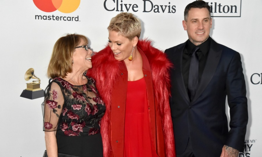 Family date night! Pink was sandwiched with love at the Clive Davis outing, where the hit singer walked the carpet with two dates - mom Judith Moore and hubby Carey Hart. The trio seemed to have a blast throughout the night, mingling with stars like Lorde and Julia Michaels once inside the venue.