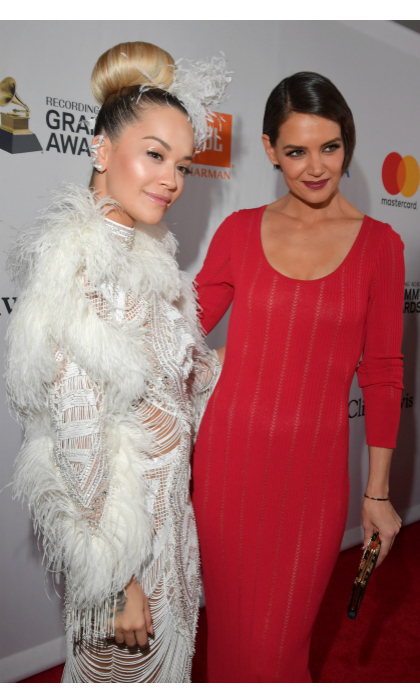 Red and white! Rita Ora and Katie Holmes looked like an angel-devil duo as they walked the carpet. The lovely ladies wore form-fitting dresses - Rita's an intricate feathery and beaded number, while Katie's was a simpler bright-red design.